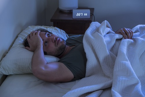 How can I stop my back from hurting when I sleep